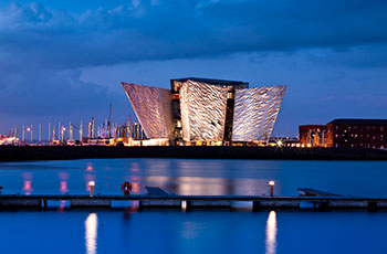 This is an image of the Titanic Museum in Belfast at night.
