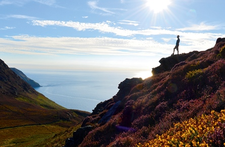 A person enjoying the stunning views of the Raad ny Foillan coastal path
