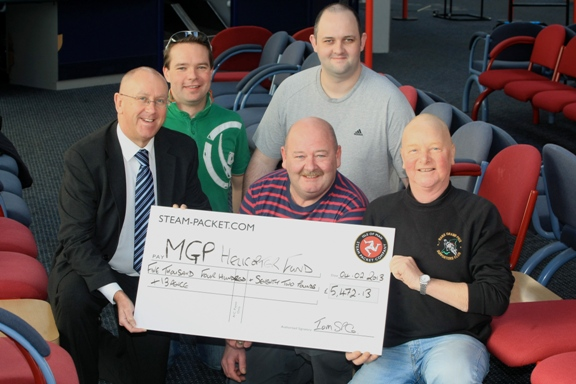 Steam Packet's Brian Convery, Ales Neuwirt, Chris Brown, Paul Turton and Bob Taylor of the MGP Supporters Club