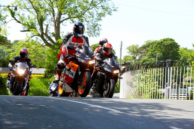 Motorcycles at the iconic Ballaugh Bridge on the famous TT course