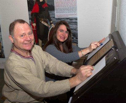 Manx Museum Site Manager Alan Kinvig shows Isle of Man Steam Packet Company Marketing and Online Manager Renee Caley around the Heroes exhibition