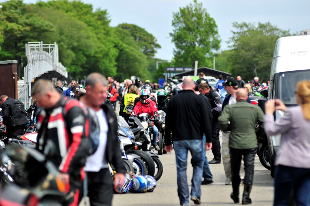 Image of the hustle and bustle at the Isle of Man TT Grandstand during TT