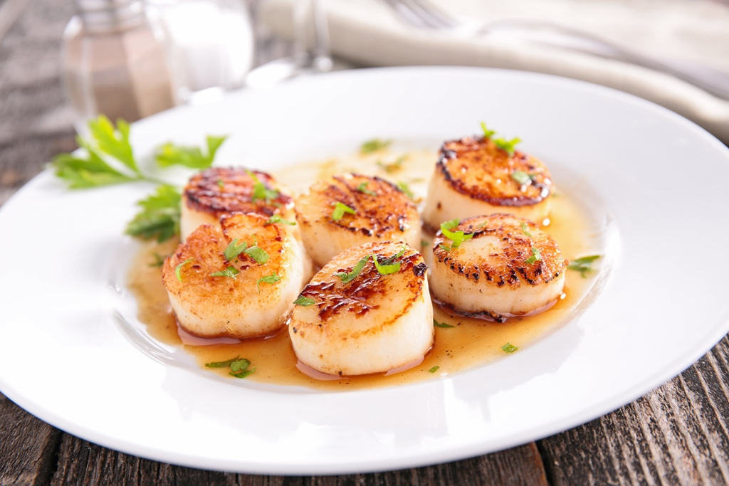 This image is of the Manx delicacy known as Queenies or queen scallops.