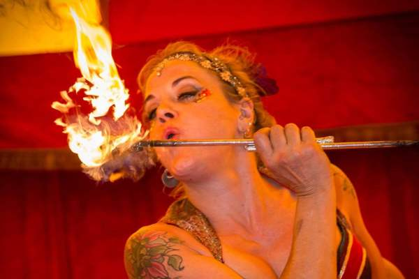 This is an image of a lady breathing fire at the circus at Milntown estate Isle of Man