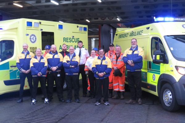Hogg Motorsport crew with Steam Packet Company staff as they boarded the Ben-my-Chree for the Rally of Mull, alongside the new rescue ambulance (left) and emergency unit