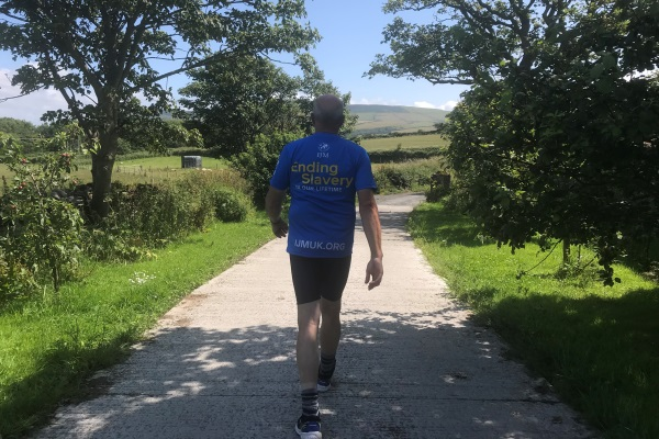 Manxman John Anderson is taking on the length of Great Britain on foot to raise money and spread awareness of worldwide slavery