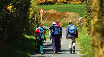 A group of people hiking through the hills of the Isle of Man