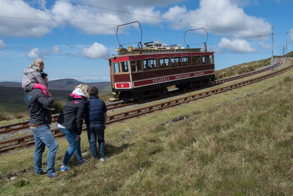 Family on Snaefell watching the Manx Electric Railway pass by