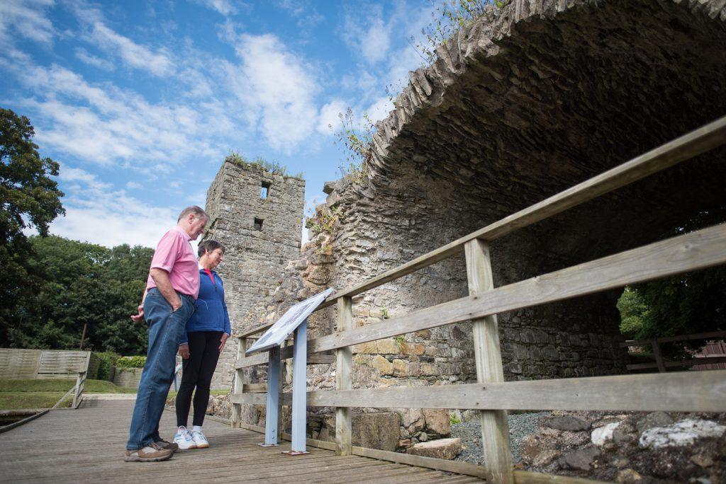 Couple exploring the gardens at Rushen Abbey, Ballasalla