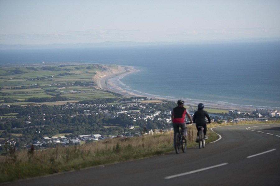 Two cyclists on the Mountain Road with a view looking out over Ramsey Bay