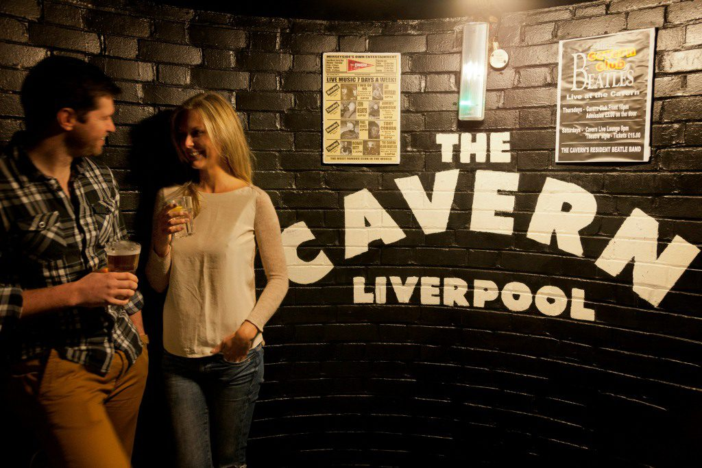 A male and female enjoying a drink in The Cavern Club, Liverpool.
