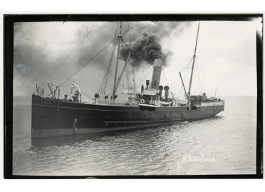 A black and white image of Steam Packet Company vessel Fenella on a calm sea with black smoke coming out of her engine