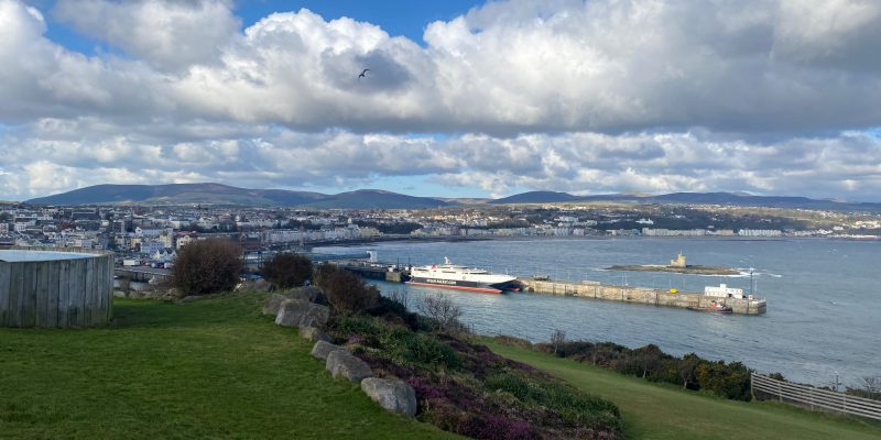 Photo from Douglas Head with green grass in the foreground and Steam Packet Company vessel Manannan in Douglas Harbour