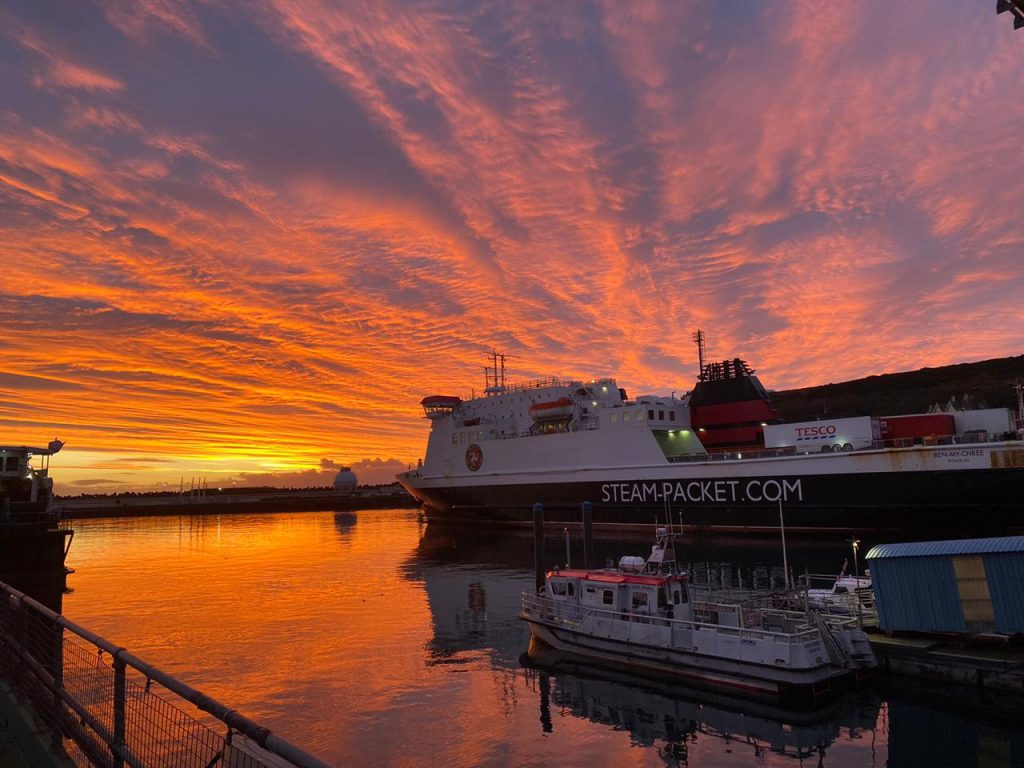 The Ben-my-Chree in Douglas Harbour in still waters against an orange sunrise