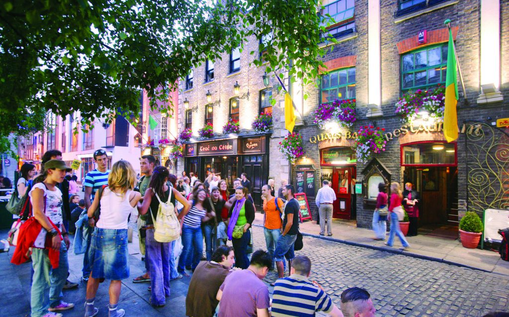 Crowds of people enjoying a drink in Temple Bar, Dublin