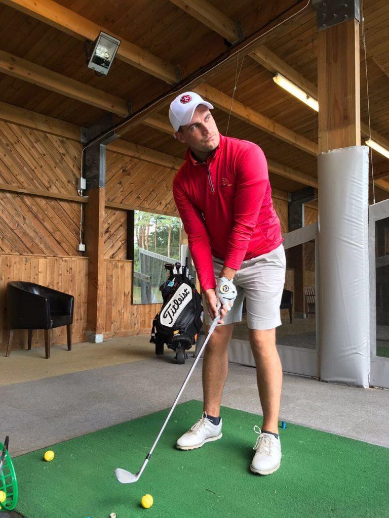 Tom Gandy practising his golf swing